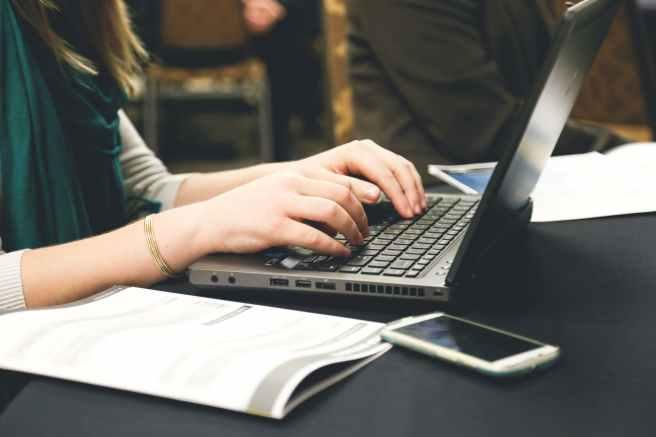 woman-typing-writing-windows.jpg